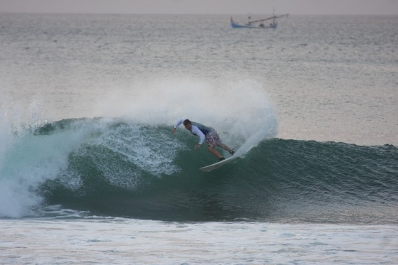 Joel sends up a bit of spray after another Bingin barrel