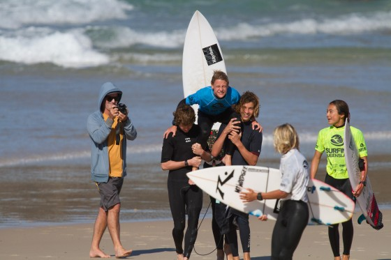 Maddy Job chaired up the beach by Toby and Liam after his win in the Under 16 final... Maddy is one of three groms off to the Australian Titles