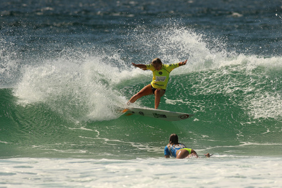 Lucy Callister taking down WCT surfer Pauline Ado in her heat at the Kommunity Pro