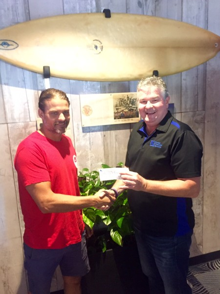 Ian Fraser from Fraser Financial Services hands over another cheque to Club President, James Lewis, in support of Burleigh Boardriders
